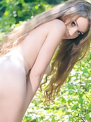 Amazing busty teen chick with groomed long hair showing sweet pussy and tight ass outdoors.
